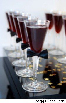 Champagne flutes with bow ties  - decoration for a murder mystery game - see www.bepartofthemystery.com