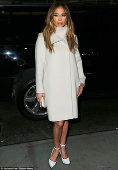 Brave: Jennifer Lopez wore a white coat as she attended a New York screening of her latest film on Wednesday