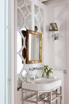 Pretty Powder room - love this mirrored wall<3