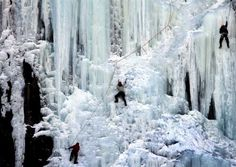 ce climbers make their way up a wall of ice in Harts Location, N.H. (Photo: Jim Cole/AP)