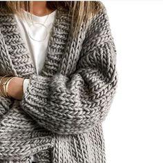 Big knit. Cosy winter fashion. Grey
