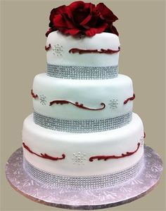 White wedding cake with red and diamante detailing