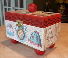 cute recipe box created with paper mache box & paper products from Crafty Secrets. I save wooden beads to use as handles/feet on my altered box projects (and cigar box purses)