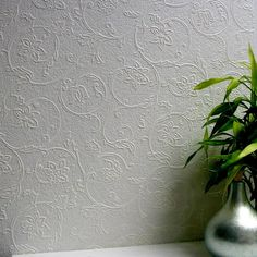 This exquisite scroll pattern brings both rustic charm and flourishing beauty to walls. Swirling leaves abound atop a mottled stone backdrop for a customizable