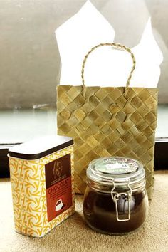 Gift ideas for principal sponsors with goodie bayongs, each containing a can of Max Brenner Hot Chocolate Powder Mix and a jar of freshly ground kapeng barako from Batangas.