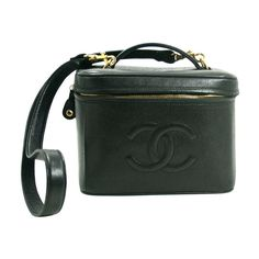 1990's Chanel Black Caviar VAnity Case with Strap   From a collection of rare vintage handbags and purses at https://www.1stdibs.com/fashion/accessories/handbags-purses/