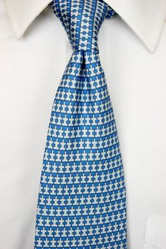 Silk 7 Fold Printed Neat Tie $95  - 60% of the sales will be donated directly to Autism Speaks
