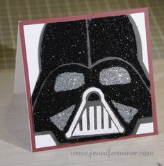Is the Force strong with you?? How could it not be, I am assuming that the Force is contained in glitter. Isn't that how that works? Okay, I guess not but I still had a blast creating this card for my Vader obsessed daughter. I created the head shape in my Silhouette Studio and then applied Wow! glitter using Glue n' Seal after I assembled it. For complete details please visit: http://www.jenniferminer.com/?p=1262 or to watch a high speed video of the creation at https://youtu.be/VFEv2d5...