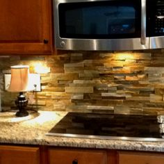 Backsplash- planning on using this around my fireplace- should I continue it to behind my stove to tie in my open floor plan?