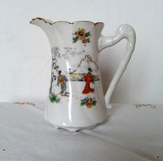 Limoges pitcher, antique jug, vintage French, collectibles, 1920s, French porcelain, country home decor, time for tea, shabby chic, antique milk jug.  This beautiful antique milk jug dates, we believe, from the 1920s. It is in excellent condition with no chips or cracks. The gilt is slightly worn but hardly noticeable considering its age.  It has unusual japanese transferware which is slightly damaged through wear but very little.  It was made in Limoges, France and decorated by Michelaud…