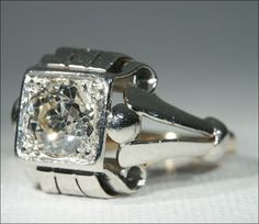Extremely stylish Art Deco diamond solitaire ring.  Hand wrought platinum top and 1.55 carat old European cut diamond with stunning sparkle.  So unusual!