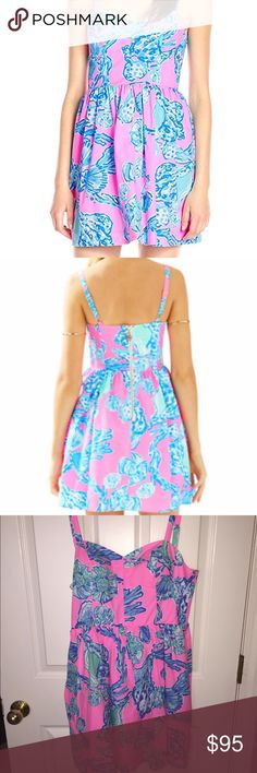 Lilly Pulitzer Ardleigh Dress in Pink Pout Sleeveless dress in printed cotton poplin. Fitted bodice and full skirt. Adjustable shoulder straps. Sweetheart neckline. Built-in soft cups. Elastic smocking on the side bodice for a close fit. Natural waist seam. Onseam hand pockets. Exposed back zip closure with novelty pull. Lined. Shell & Lining: 100% cotton. Lilly Pulitzer Dresses