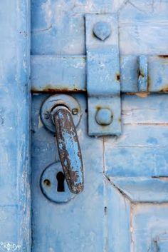 Blue door in Greece. by Kat Sloma