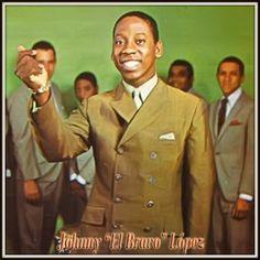"""Johnny López """"Johnny El Bravo"""" (Nace el 4 de Mayo de 1944 en Puerto Rico). Gran Timbalero que brilló con luz propia gracias al éxito de su propia Orquesta. Por ella pasaron soneros como Junior Córdova, el mismo de """"La Cinta Verde"""" y """"El Número Seis"""". También se destaca la participación como coristas de Héctor Lavoe y Bobby Cruz en el álbum """"La Salsa de Puerto Rico"""", cuyo gran éxito fue el clásico de Celia Cruz con la Matancera """"Guede Zaina""""."""
