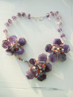 Striking amethyst and multigem statement necklace by blueladybird designs Amethyst, Gems, Trending Outfits, Unique Jewelry, Handmade Gifts, Bracelets, Vintage, Design, Handcrafted Gifts