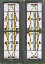 Jaap Gidding, own workshop  A PAIR OF STAINED AND LEADED GLASS WINDOWS