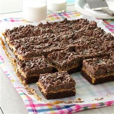 Chocolate & Peanut Butter Crispy Bars Recipe - 1 package fudge brownie mix (13x9-inch pan size) 1-1/2 cups chunky peanut butter 2 cups (12 ounces) semisweet chocolate chips 1 cup creamy peanut butter 3 cups Rice Krispies