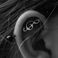 Industrial piercing with musical note. on The Fashion Time  http://thefashiontime.com/5-cute-fun-ear-piercing-ideas/#sg22