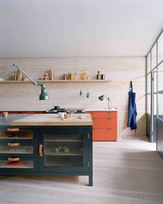 Bespoke Color from an Accidental Decorator: Remodelista  Scroll down for dark grey/olive kitchen cabinetry/island