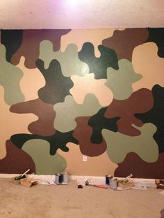 Camo wall. I drew shapes, painted 2 coats with 4 colors never letting a color be next to itself.