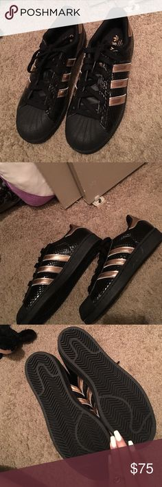 Brand new never worn superstars Brand new black and rose gold/copper color accent. Adidas Shoes Sneakers