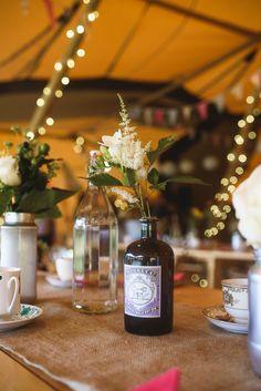 Gin Bottle Flowers Decor Centrepiece Colourful Outdoorsy Festival Tipi Wedding www. Wedding Reception Flowers, Tipi Wedding, Rustic Wedding Venues, Home Wedding, Wedding Table, Wedding Ceremony, Simple Wedding Decorations, Wedding Themes, Wedding Ideas