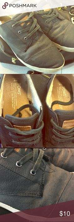 """Toms size 8 black vegan leather sneakers shoes These show some wear (see pic of """"leather"""") on the surface and in that the sole is separating a little around one of the toes but we're well taken care of and only worn a few times.  My first Poshmark item!  Pricing low and trying to be clear about any issues:). Will ship within 1 day! TOMS Shoes Sneakers"""