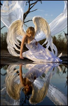 I look into Her mirror and see where wishes need gifting, dreams need seeing and hope needs Her love to fly.