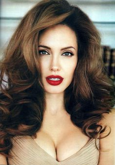 Angelina Jolie - Long dark brown high volume hairstyle with loose curls and light brown highlights and eye makeup