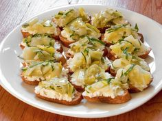 Ricotta and Braised Leek Crostini RecipeRich, creamy ricotta cheese makes a perfect base for soft, sweet leeks braised with basil. Soft braised leeks are accented with basil and rounded out . Potato Appetizers, Appetizer Recipes, Popular Appetizers, Cocktail Party Appetizers, Salsa, Dog Recipes, Party Recipes, Party Snacks, Recipies
