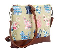 Small light beige crossbody messenger shoulder bag with a cat pattern brown faux leather trim coated canvas matt finish oilcloth style fabric The bag