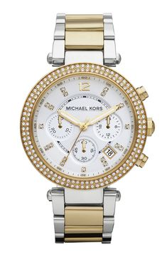 Luxurious crystal markers add such flare to this gold and silver Michael Kors watch.