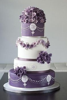 Wedding cake with purple and white color decorations | wedding cakes | | wedding cake | | wedding| #weddingcakes #wedding http://www.roughluxejewelry.com/