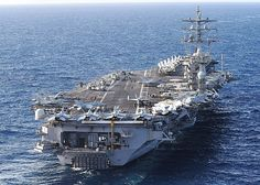 The aircraft carrier USS Dwight D. Eisenhower (CVN 69), the flagship of the Eisenhower Carrier Strike Group, transits the Atlantic Ocean.