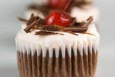 Gluten Free  Black Forest cupcakes made with butter, eggs, vanilla, gluten free flour, cocoa powder, almond milk, whipping cream, and powdered sugar.