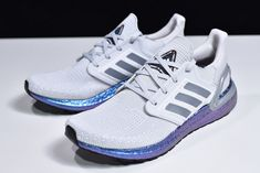 adidas and NASAs ISS US National Lab commit to leading innovation by creating an UltraBoost 2020 collection to be tested in space. this edition hosts a grey Primeknit bootie with ornate weaves reinforcing the toe, a modernized Three-Stripes midfoot cage and 3D frame supporting its neoprene heel. An iridescent blue Boost midsole and rubber outsole afford the sneaker response and control. New Adidas Ultra Boost, Ultraboost, Cage, Iridescent, Innovation, Adidas Sneakers, Stripes, Booty, 3d
