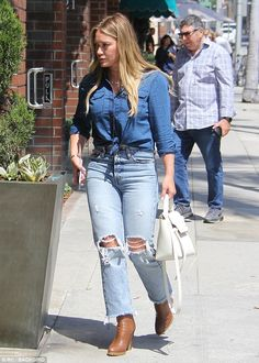 ca4cc78b3303 Hilary Duff steps out in casual shirt and torn jeans combo for chores
