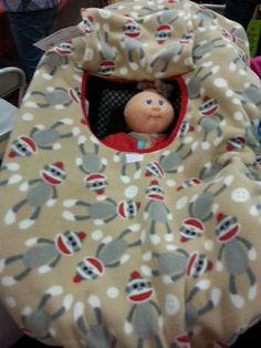 Double Fleece Sock Monkey Cozy Cover Up for Infant Baby Car Seats. $27.50, via Etsy.