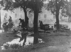 Women prepare food outdoors in the Theresienstadt ghetto. Theresienstadt, between 1941 and 1945.