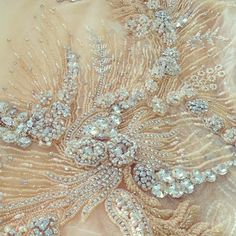 Tambour Beading On A Haute Couture Piece... Crystals Beaded , Silk Tulle Fabrics.