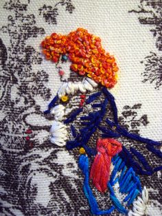 Richard Saja embroidery.  Love the blended thread in the french knots in the hair.