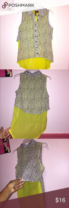 Super cute high-low Blouse!! Sheer White/yellow/black Polka dot blouse!! So cute for the office or really any occasion. It's a high/low sleeveless button down blouse. Slightly see thru, bright and yellow! Soft and silky. Definatley a keeper. Easy to wear. Will take offers Tops Blouses
