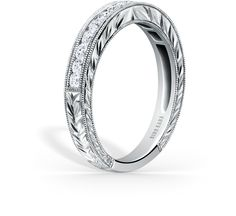 This timeless classic is a ladies' band from the Pirouetta collection. It features 0.42 ctw of diamonds. The signature handcrafted details include wheat hand engravings and milgrain edging.