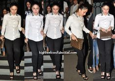 Kareena was photographed exiting a Mumbai eatery wearing black plants and a white shirt with beaded collar. With her hair in a ponytail, she finished out the look with a Louis Vuitton clutch, Bulgari Serpenti watch and her style staple, Saint Laurent sandals. Like Ms. Kapoor's off-duty look? Kareena Kapoor Photo Credit: Viral Bhayan More …