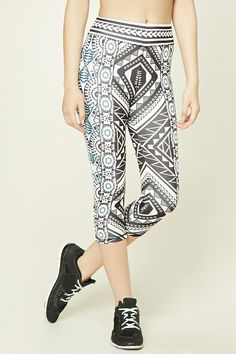 A pair stretch-knit capri leggings featuring an allover ornate print and elasticized waist.