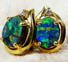 rich firery boulder opal 18k gold earring $640 http://www.jewelry-auctioned.com/auctions/rich-firery-boulder-opal-18k-gold-earring-cj1699-17103