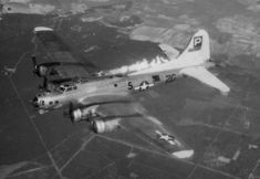 A B-17G of the 836th Squadron burns after cannon fire from a German Me-262 ripped into its tail, perforating the vertical stabilizer and the inboard right wing panel. Fire from the No. 3 engine swept back to the tail. The bomber peeled off shortly afterwards and dropped behind, with the crew bailing out at its rendezvous point seven miles west of the Elbe River.