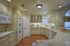 new venetian gold granite with antique white cabinets - Google Search