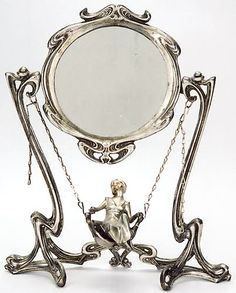 A SILVERED-BRONZE FIGURAL VANITY Art Nouveau taste. The circular mirror on frame from which are chains supporting swing chair with woman in long gown. Height 17 in., width 14 in. Motifs Art Nouveau, Art Nouveau Design, Style Floral, Jugendstil Design, Art Nouveau Furniture, Circular Mirror, Beautiful Mirrors, Oeuvre D'art, Love Art