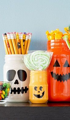 Follow these easy steps to make a Halloween Treat Bar: recycle and paint old salsa, spaghetti sauce or jelly jars, fill them with your favorite wrapped candy and other goodies for guests at your next party. #craft #diy #party #favors